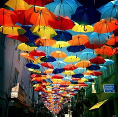 Floating Umbrella Installation in the Streets of Agueda, Portugal - Amazing Street Art Umbrella Street, Umbrella Art, Instalation Art, Colorful Umbrellas, Colourful Art, Colossal Art, Land Art, Art Festival, Public Art