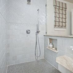 Like the tile pattern on shower wall; use of various tile shapes. Use Arabesque on top, glass waveline tile and/or subway streamline tile on bottom? Transitional Bathroom by Nicole Arnold Interiors