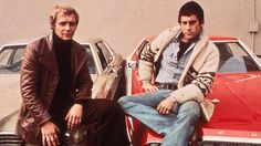 David Soul and Paul Michael Glaser sitting on the hoods of their cars, from the television series, 'Starsky and Hutch,' circa 1977. (Photo by Frank Edwards/Fotos International/Getty Images)   - Esquire.com