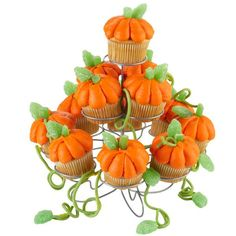 Towering Pumpkin Patch Cupcakes - Such an awe-inspiring collection of harvest-ready cupcakes! Use tip 2A to pipe pumpkins on cupcake tops, add green leaves and green string licorice. These are featured on our 13-Count Cupcakes-N-More Dessert Stand.