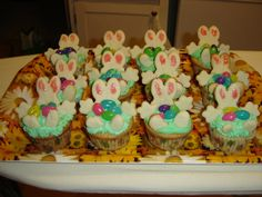 Easter cupcakes I made a few years back for the kids in my class. They are suppose to be bunny rabbits that fell into the grass with their easter eggs. I used jelly beans and the bunnies were sugar cookies.