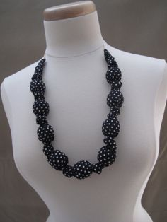 Nursing Necklace Chunky Black with White Dots fabric covered wooden beads by AbbieGraceDesigns, $15.00 Cute fashion accessory for Mama that Baby can safely bite on to reduce teething pain. Keeps Baby focused on nursing too, by giving her something to tug on and play with (besides YOU)!