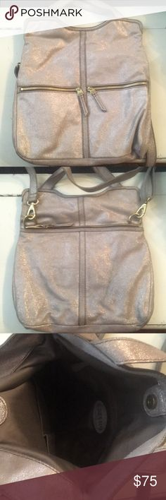 Fossil messenger bag Sparkly treated leather. Fold over top. Some jean rubbage on one side. Shown in picture. Fossil Bags