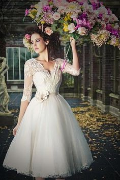 Vestido de noiva curto com renda romântico
