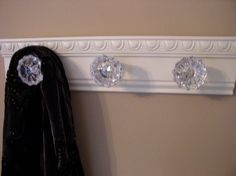 Beautiful coat rack with 3 glass door knobs and decorative beveled moulding. shabby chic style ideal for robe purse coat or decor only. $41.00, via Etsy.