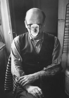 Artist Saul Steinberg, wearing mask, at party at home of Alexander Calder. 1959.