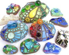 Mosaic Stones - Gorgeous For The Garden!  Wine bottles, marbles, mirror bits, broken dishes, bits of jewelery, BB's... it is amazing what you will find.  Make some for your friends gardens... let them think of you when they glance upon uplifting color. A rock, some grout, colorful bits of glass and such = creative beauty.
