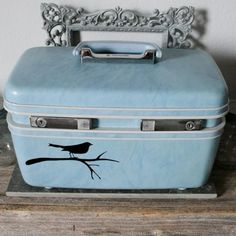 No how-to but LOVE the vinyl decal of the bird on the suitcase