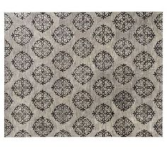 Even though this rug is gray it goes well with tans and taupes. It has a variety of colors woven into it. Very stunning. Empire Scroll Rug - Gray #potterybarn