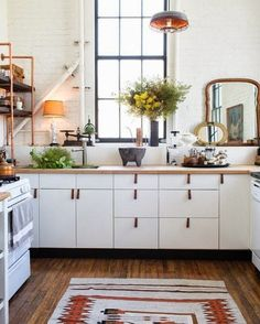 White Kitchen - An Ikea kitchen with custom details such as leather pulls, black baseboards, and shelves with copper piping Rental Kitchen, Ikea Kitchen, Kitchen Interior, Kitchen Decor, Rustic Kitchen, Kitchen Black, Kitchen Rug, Vintage Kitchen, Kitchen Cost