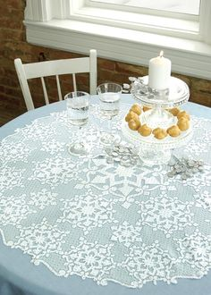 Create a sparkly winter wonderland centerpiece with the Glisten Round Table Topper from @Heritage Lace, silver accents and crystal dishes. #tablescape #holiday decorating