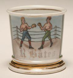Occupational shaving mug, Boxer. Gilt trim, J J Lang Barber Supply. Good condition, minor wear.