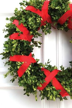 Yule style!! Noel Christmas!! DIY!! Boxwood wreath with red ribbon tied in X-pattern! Elegant and simple for a front door!