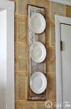 A savaged chippy wood door panel and a few vintage plates make a beautiful wall display! Find more repurposed project ideas at Knick of Time.