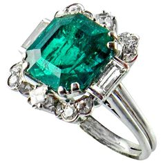 Colombian Emerald Ring | From a unique collection of vintage solitaire rings at http://www.1stdibs.com/jewelry/rings/solitaire-rings/