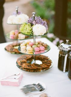 lovely styling >> sweet treats on cake stands with flowers on the top tier