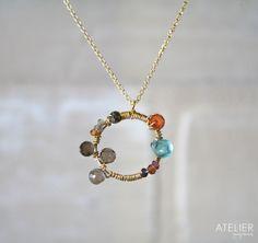 FUN GEM NECKLACE!! <3 Goldfilled, tundra sapphire, smokey quartz, apatite, cornaline. Available at: www.facebook.com/ateliergabymarcos