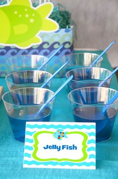 Jelly Fish - Blue Jello in transparent plastic cup with blue spoon