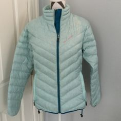 Helly Hansen mountain professional jacket Beautiful Aqua and teal colored Helly Hansen jacket is the perfect thing to keep you warm this winter. Light, travels easily, not bulky but will definitely do its job. Helly Hansen Jackets & Coats