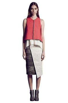 The sleek Clarity tank is a sharp statement skirt in Vermillion red or Charcoal. The bonded and laser cut fabrication gives a sculptural shape while the unlined construction allows for feature contrast details in seams and inside hems. The neck and dropped back waist gives a sharp proportion and balances out softer skirts and trousers. Style with a coordinating Clarity Skirt for ultra modern eveningwear with an Alchemy sandal and Sonic clutch. #GingerandSmart