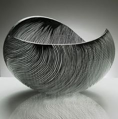 black and white ceramic biomorphic formed bowl. textured.