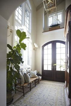 A great shot of the two-story entry of this Tom Christ designed home. Featured in Trad Home Magazine. Interiors by @erika powell