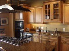 maple cabinets - like this kitchen, but need more color in the kitchen.