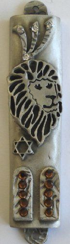 "Pewter Mezuzah with Lion of Judah and Ten Commandments Decorated with Swarovski Crystals and Kosher Mezuzah Scroll by Swarovski Components. $69.99. Comes with a Kosher mezuzah scroll. Swarovski Crystals. Genuine Pewter Mezuzah. This beautifully crafted pewter Mezuzah, which is approximately 3 1/4 inches tall, is highlighted by Swarovski crystals. The mezuzah depicts the ten commandments and the lion of Judah. The inside cavity is approximately 3"" long. The shin is ado..."