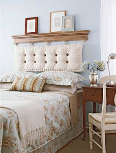 For a new take on an upholstered headboard, hang a bench cushion by its ties from wall-mounted hooks. Top the hooks with a piece of over-door molding, which you can find at a home center. To create a tufted look, sew covered buttons to the cushion with ribbon, poking both ends through the bottom of the cushion. Pull the ends tight and tie.