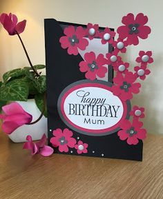 handmade birthday card from DaisyFlower: Paper flower engineering ... luv the black and Melon Mambo together ... corner of punched flowers with no support other than Tombo glue on the overlapping petals ... awesome crafting! ... Stampin' Up!