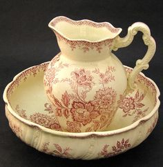 French ironstone pitcher and basin, both decorated overall with red transferware floral sprays, late 19th century, height of pitcher, 11.5, diameter of basin, 15.5