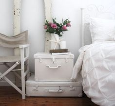 stack of white vintage suitcases... | Living out of a suitcase ...