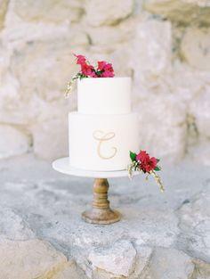 monogram wedding cake - photo by Savan Photography http://ruffledblog.com/bougainvillea-inspired-wedding-ideas