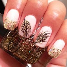 White and gold themed feather nail art. Coat your nails in matte white polish and add gold glitter on the tip of the nails as well as to highlight the feathers.