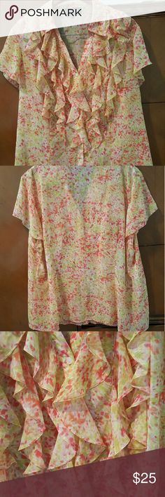Beautiful sheer summer blouse Jones of NY Romantic and feminine cap sleeve button up blouse. Coral and ivory and light green floral pattern. Perfect for work or a summer picnic. Love the colors. Sheer material and may need a   camisole or tank under it. Personal preference. Lovely soft ruffle detail. Only worn a couple times. Wonderful condition. No rips snags or pulls Jones New York Tops Blouses