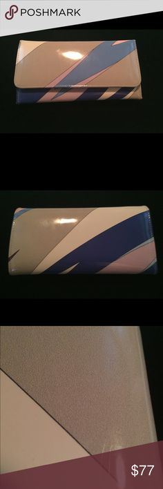 Emilio Pucci Patent Wallet Pucci patent wallet in very good condition.  Inside shows slight wear on credit card edgings, and there are two small scratches on the back (shown in picture 3). Emilio Pucci Bags Wallets