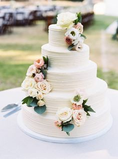 Beautiful cream simple floral wedding cake
