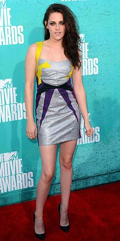 KRISTEN STEWART  Bringing her fashion A-game once again, Kristen channels a stylish superhero in a silver mini with a graphic purple-and-yellow pattern.
