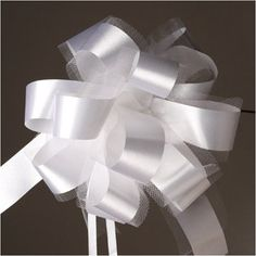 "Bows - Easy-Pull 7 inch Pew Bow - White - WeddingDepot.com - 228-PR812-01 These ivory floral satin bows are approximately 7"" inches across. Each has 2 short trailers. Assembly is easy. Each bow will have two thin ribbons that you pull to make the bow come to life. Pullling the two ribbons gathers the bow at the center. Then, use those ribbons to hang the bow.  ANYONE can quickly have bows for their wedding, rehearsal dinner, bridal showers, and more."