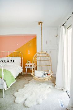 pink and yellow wall in a girls room