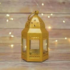 Inch Gold Taj Hurricane Candle Lantern on Sale Now from PaperLanternStore at the Best Bulk Wholesale Prices. on Sale Now! We offer vintage and unique LED candles, table decorations, wedding decor and lighting supplies in Bulk at Wholesale Prices. Bottle Candles, Votive Candle Holders, Led Candles, Tea Light Candles, Tea Lights, Hurricane Lanterns, Candle Lanterns, Paper Lanterns, Morrocan Theme