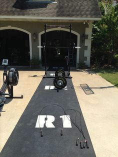 Rogue mats, jump ropes and squat rack. MY DREAM HOME GYM!