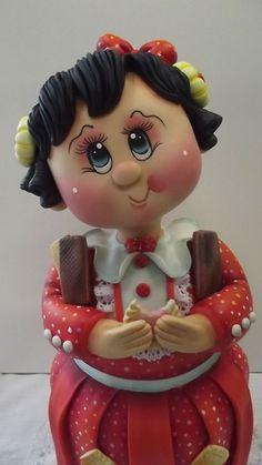 POTE MENINA BOLACHA V-  Pote de 2,0 L trabalhado em biscuit em forma de menina comendo bolacha.  As cores podem variar. (cor da roupa, cabelos e olhos)  ENCOMENDAS SOMENTE MEDIANTE PAGAMENTO DE 50% DO VALOR TOTAL (ARTIGO + FRETE), PAGO NO ATO DO PEDIDO POR DEPÓSITO EM CONTA.  VER POLÍTICAS DA LOJA.  VAGAS: CONSULTE O MÊS DE ENTREGA, ESTOU AGENDANDO CONFORME POSSIBILIDADE. O prazo de confecção é contado A PARTIR DO MÊS DE AGENDAMENTO DO PEDIDO. Preço sob consulta.