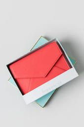 This would make a great gift for a friend or for bridesmaids. Sarah Boxed Envelope Wallet in Coral