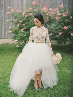 "<div>If ever there was a woman to pull of a lace crop top and tulle skirt, it's definitely this gorgeous bride—she's a former Miss Wisconsin!</div><div><br></div><div>More Dress Inspiration Inside <a href=""http://www.stylemepretty.com/vault/search/images/Wedding%20Dresses"">THE VAULT</a></div>"