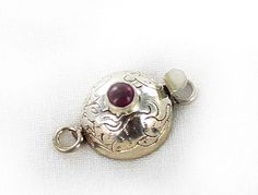 RUBY CLASP ROUND STERLING ETCHED DOME from New World Gems