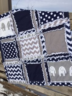 A RAG QUILT in Elephant, Chevron, and Polka Dot patterns. The perfect Baby Blanket in Navy Blue and Gray is made to order. This blanket will keep your baby warm while looking absolutely adorable. Care