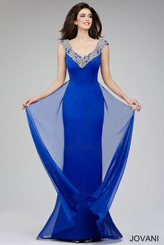 4ad85e989d7 Jovani Evenings 22647 Stunning blue cap sleeve sheath floor length gown  features a crystal embellished neckline