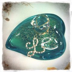 L de Lolita Lempicka pure #perfume. The whimsical #turquoise #mermaid #heart that will forever remind me of the loss of a dear friend.   #fragrance #lolita #aqua