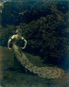 Ruth St. Denis (early modern dance pioneer) in The Peacock, on the grounds of Ravinia Park (1914).
